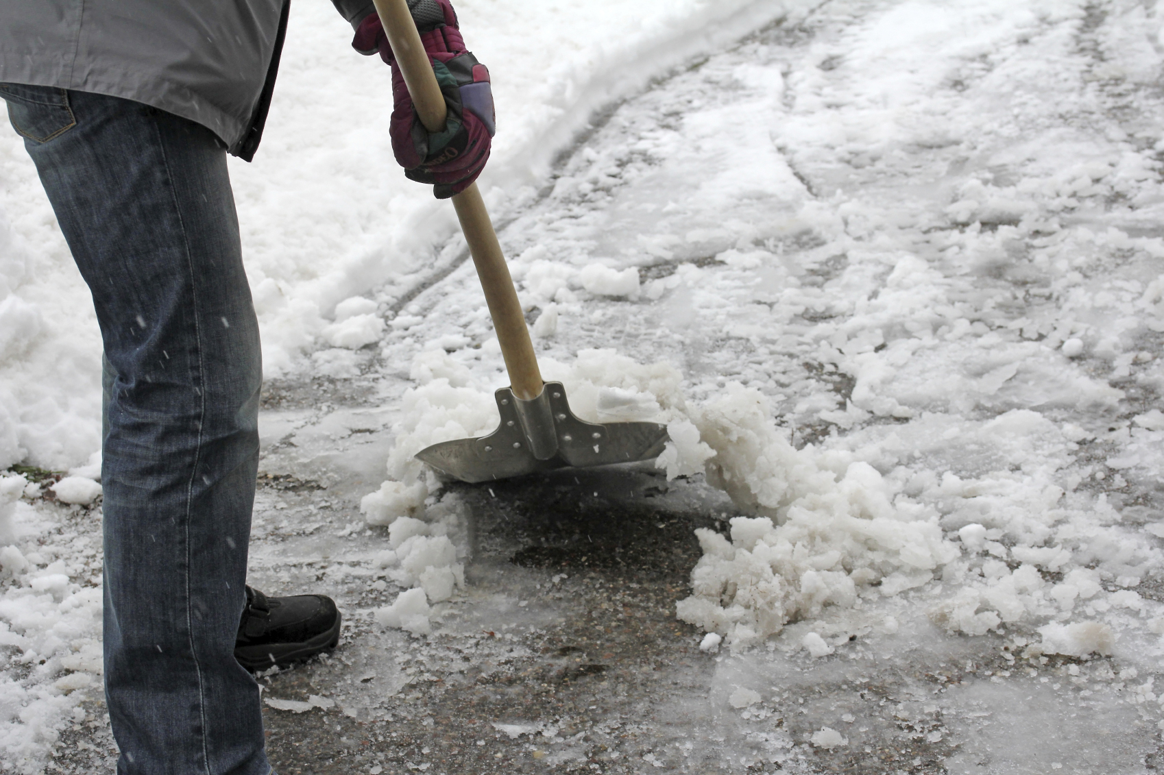 If Someone Slips on an Icy Sidewalk in Front of My Home or My Business, Am I Liable?